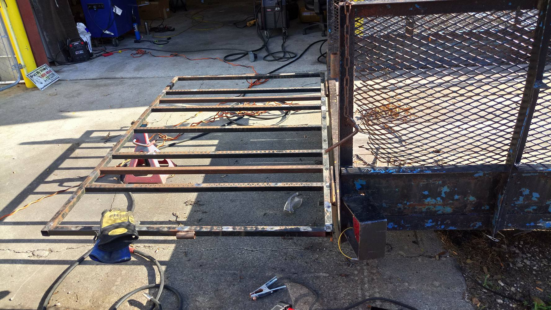 trailer gate before welding a metal mesh on