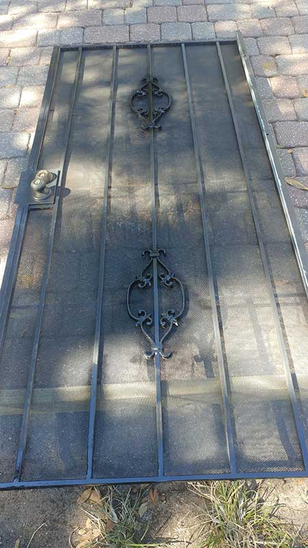 steel security door repaired and painted