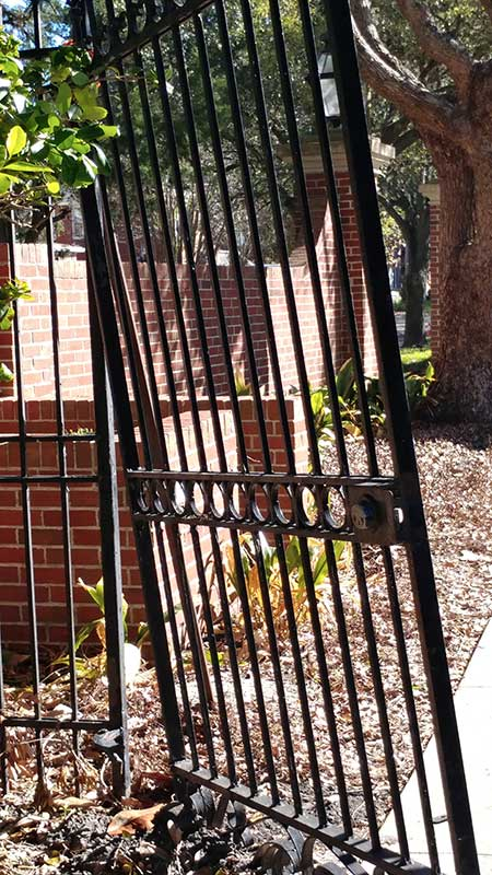 Steel security gate rusted off its hinges